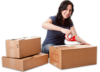 Women packing boxes for moving to storage unit